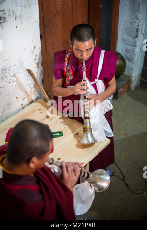 Prakhar Lhakhang, Bumthang, Bhutan.  Monks Practicing on their Oboes before Performing in a Religious Festival. - Stock Photo