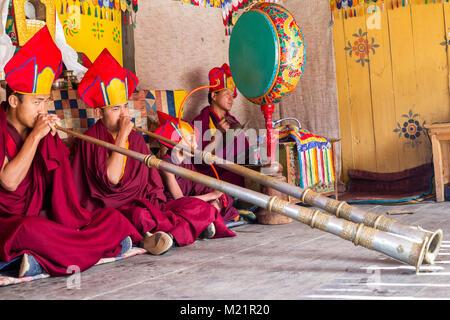 Prakhar Lhakhang, Bumthang, Bhutan.  Buddhist Monks Playing the Dungchen (Long Trumpet). - Stock Photo