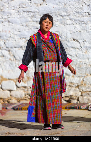 prakhar lhakhang bumthang bhutan bhutanese woman in traditional dress m21r60 Whats Really Happening With Bhutan College Girls