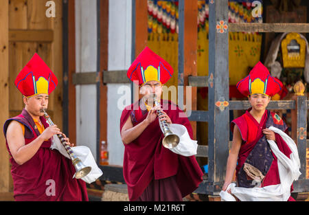 Prakhar Lhakhang, Bumthang, Bhutan.  Monks Playing Bhutanese Oboes in a Religious Festival. - Stock Photo