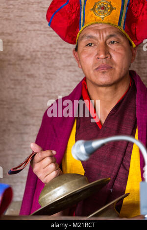 Prakhar Lhakhang, Bumthang, Bhutan.  Buddhist Monk Playing the Cymbals. - Stock Photo