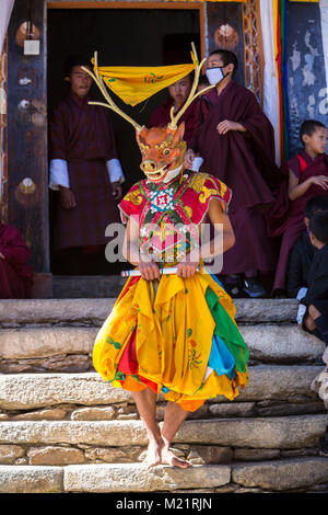 Prakhar Lhakhang, Bumthang, Bhutan.  Buddhist Monks Emerging from the Monastery to Perform a Dance in the Duechoed - Stock Photo