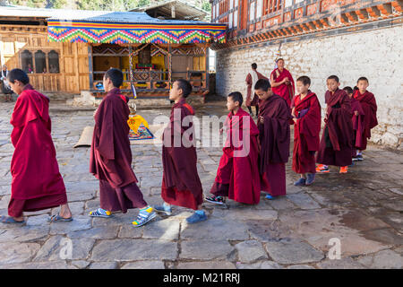 Prakhar Lhakhang, Bumthang, Bhutan.  Young Monks in the Courtyard. - Stock Photo