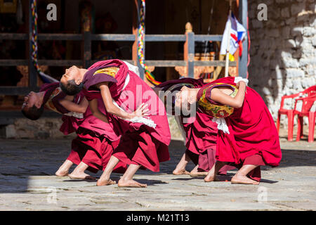 Prakhar Lhakhang, Bumthang, Bhutan.  Monks Performing a Dance at the Duechoed Religious Festival. - Stock Photo
