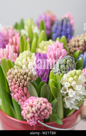 Flower shop concept. Mixed color. Fresh spring flowers in refrigerator room for flowers. Bouquets on shelf, florist - Stock Photo