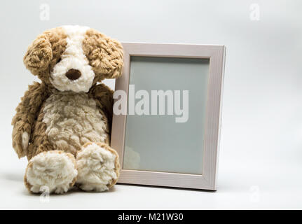 Teddy bear with photo frame isolated on white background Stock Photo ...