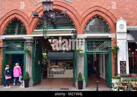 Red brick and green painted wood facade of Georges Street Arcade in center of Dublin. - Stock Photo