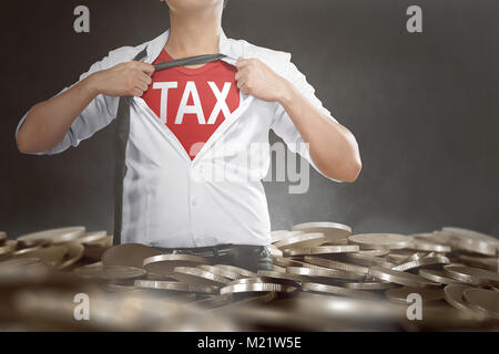 Businessman tearing his shirt showing Tax text on his chest with coins pile background - Stock Photo