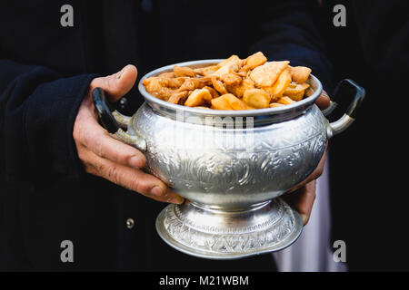 Two hand holding a bowl with full of fresh Nimki. - Stock Photo