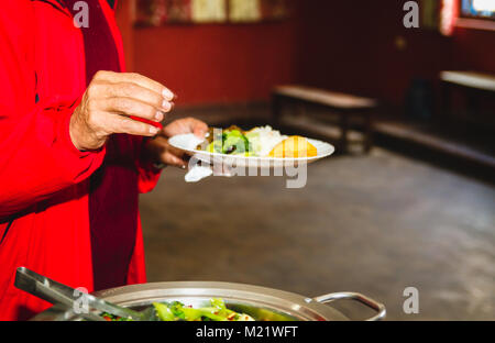 People taking food from buffet at the party. - Stock Photo