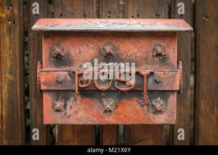 An old vintage rusty mailbox in Klosterneuburg, Austria - Stock Photo