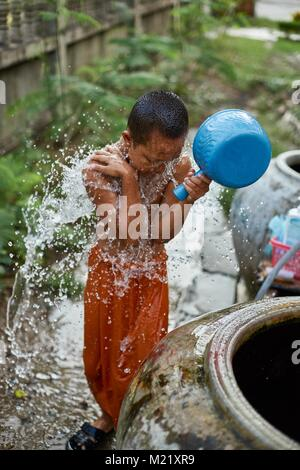 Young novice monk in monastry, Battambang, Cambodia - Stock Photo