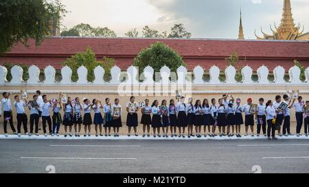 Schoolchildren cheering for Cambodian King, Royal Palace, Phnom Penh, Cambodia - Stock Photo