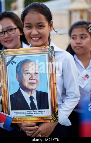 Schoolgirl cheering for Cambodian King, Royal Palace, Phnom Penh, Cambodia - Stock Photo