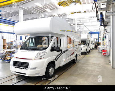 quality control of finished assembly of motorhomes / camper vans in the production line in a factory - Stock Photo
