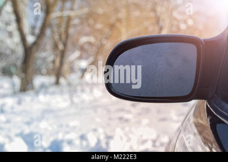 The rear view window is covered with hoarfrost, against a background of soft focus. Soft background with a rear - Stock Photo