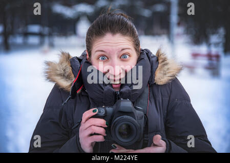 Happy photographer capturing winter images - Stock Photo