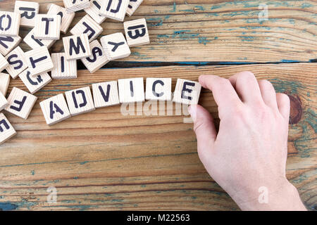 advice. Wooden letters on the office desk, informative and communication background - Stock Photo