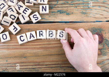 carbs. Wooden letters on the office desk, informative and communication background - Stock Photo