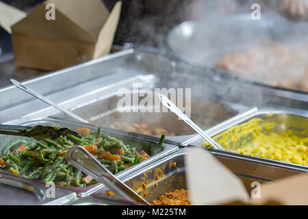 Takeaway food at a market stall in Borough Market, London - Stock Photo