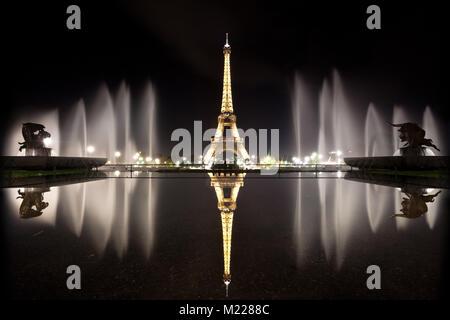Eiffel tower at nighttime, Paris, France. - Stock Photo