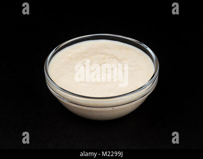 Horseradish sauce isolated on black background - Stock Photo