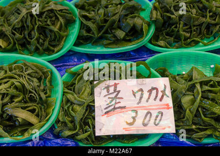 Selective focus on wakame seaweed at a stall in the Nishiki Market, Kyoto, Kansai, Japan - Stock Photo