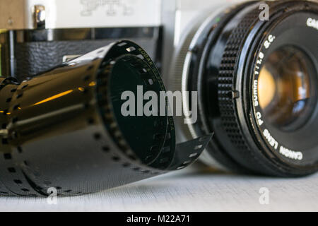Canon FTB single-lens reflex camera with roll of kodak safety film in foreground - Stock Photo