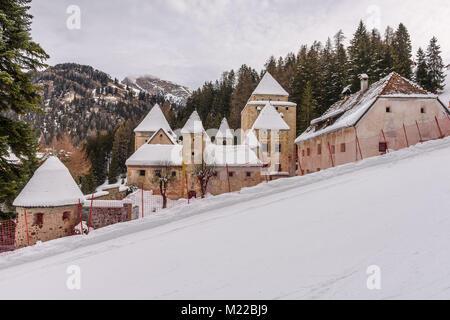 Winter view of Castel Gardena in Santa Cristina Valgardena, alpine village of the Dolomites - Stock Photo