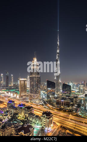 Dubai, UAE - Jan 19, 2018: Colorful sunset view of Dubai Downtown district landmarks and skyscrapers. - Stock Photo
