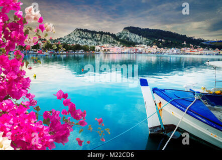 fishing boats in Zaante town harbour, Zakinthos Greece with flowers - Stock Photo