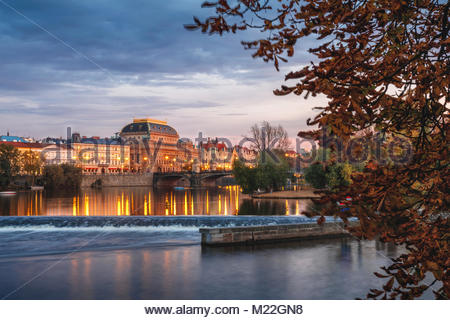 Image of Prague riverside with reflection of the city in Vltava River and National Theatre - Stock Photo
