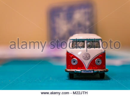 Front of a Volkswagen Van Samba toy bus with logo on a table in soft focus on circa January 2018 in Poznan, Poland - Stock Photo