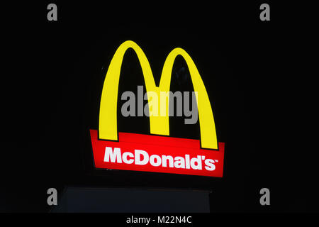 BURGAS, BULGARIA - FEBRUARY 1, 2018: McDonald's logo at night. McDonald's is the world's largest chain of hamburger - Stock Photo
