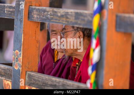 Prakhar Lhakhang, Bumthang, Bhutan.  Two Buddhist Monks Talking. - Stock Photo