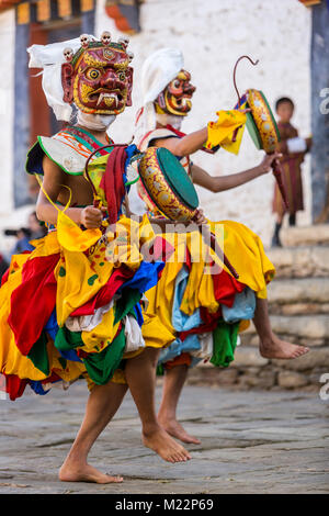 Prakhar Lhakhang, Bumthang, Bhutan.  Buddhist Monk Wearing Mask of a Mythological Deity while Performing a Dance - Stock Photo