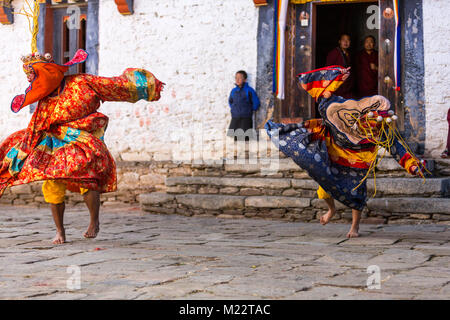 Prakhar Lhakhang, Bumthang, Bhutan.  Buddhist Monks Performing a Dance in the Duechoed Religious Festival. - Stock Photo