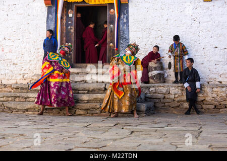 Prakhar Lhakhang, Bumthang, Bhutan.  Buddhist Monks Wearing Masks of Mythological Deities  while Performing a Dance - Stock Photo