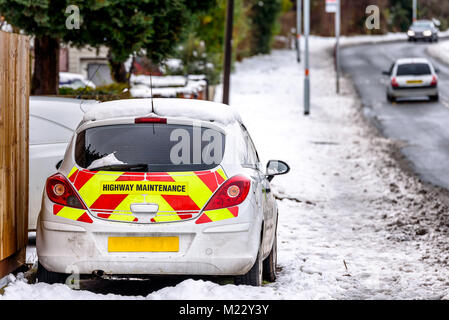 Day view UK Motorway Highway Maintenance car parked on snowy road - Stock Photo