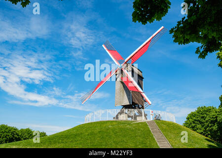 Sint-Janshuis Mill, windmill with few cloud and blue sky background in Brugge, Belgium. - Stock Photo