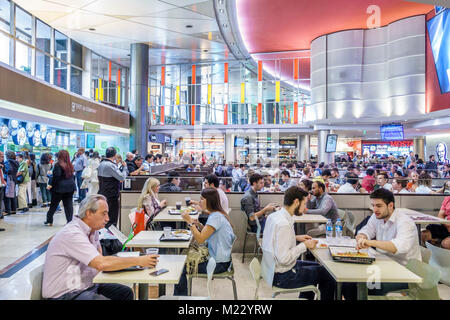 Buenos Aires Argentina Galerias Pacifico mall shopping food court dining tables busy crowded tables man woman Hispanic - Stock Photo
