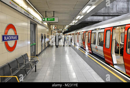 London Underground Blackfriars station platform step free train access for wheelchair disability back view of passengers - Stock Photo