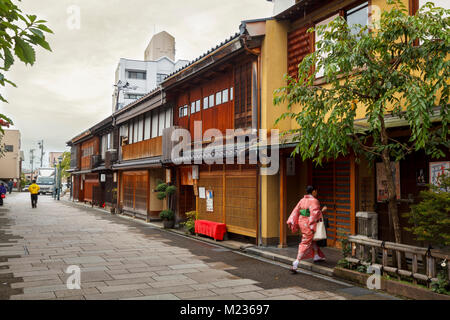 Nishi Chaya district streets, a traditional japanese style district with a woman dressed in kimono entering a hous