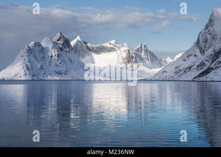 A view of mount Olstind on the Lofoten islands on a winter morning - Stock Photo