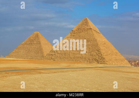 The Great Pyramid of Khufu (or Cheops)  and the Pyramid of Khafre (or Chephren) on the Giza Plateau, Cairo, Egypt - Stock Photo
