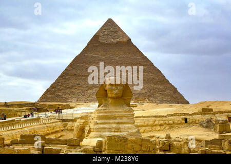 The Great Sphinx statue and the Pyramid of Khafre on the Giza Plateau, Cairo, Egypt - Stock Photo