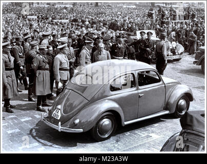 1930's ADOLF HITLER with DR. PORSCHE at the launch event of 'the people's car' KDF VW Volkswagen Beetle prototype - Stock Photo