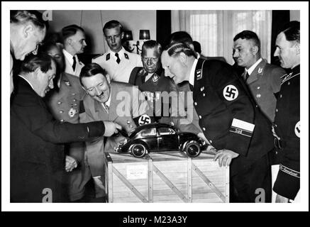 1930's Dr Porsche showing Adolf Hitler a scale model of his unique air cooled engine and inspired design... 'the - Stock Photo
