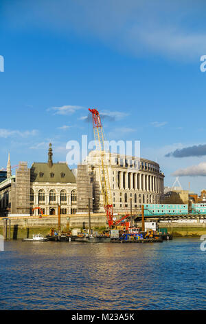 Cranes on the Blackfriars Bridge foreshore on Victoria Embankment, London working to construct the new Super Sewer - Stock Photo