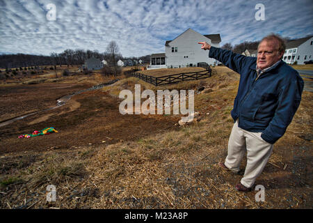 UNITED STATES: 2018: George Biller a resident of Historic Selma Estates points out what he says are flaws in the - Stock Photo